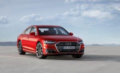 • Για πρώτη φορά αυτόνομες λειτουργίες οδήγησης level 3, σε όλες τις εκδόσεις του νέου Audi A8 • Νέα γλώσσα σχεδίασης και πρωτοποριακή τεχνολογία χειρισμού αφής η οποία καταργεί τους διακόπτες • Νέοι επανασχεδιασμένοι κινητήρες με κορυφαία ισχύ • Παγκόσμια πρώτη εφαρμογή νέων συστημάτων ενεργούς ηλεκτρομηχανικής ανάρτησης με μόνιμη τετρακίνηση quattro και δυναμικό σύστημα διεύθυνσης όλων των τροχών Η Audi παρουσίασε πριν από λίγες ημέρες στο Audi Summit που πραγματοποιήθηκε στη Βαρκελώνη, το νέο Audi A8, το πιο εξελιγμένο αυτοκίνητο στον κόσμο. Στην τέταρτή της γενιά η ναυαρχίδα της Audi αποτελεί και πάλι το σημείο αναφοράς για την πρόοδο μέσω της τεχνολογίας (Vorsprung durch Technik), με νέα πρωτοποριακά συστήματα και καινοτόμες τεχνολογίες που βρίσκοναι κάτω απο την ομπρέλλα του Audi AI. Αλλά τι σημαίνει ΑΙ? Είναι τα αρχικά των λέξεων Artificial Intelligence(Τεχνητή Νοημοσύνη) δηλαδή είναι νοημοσύνη που αναπτύσεται απο μηχανές και στην επιστήμη των υπολογιστών, το πεδίο έρευνας ΑΙ οριοθετείται ως μελέτη 'ευφυών παραγόντων' βάσει της οποίας η κάθε συσκευή αντιλαμβάνεται το περιβάλλον και αναλαμβάνει δράσεις που μεγιστοποιούν την πιθανότητα επιτυχίας σε κάποιο στόχο. Eκτεταμένη δικτύωση, αυτοματοποίηση και ηλεκτροκίνηση - είναι τα χαρακτηριστικά που καθορίζουν την Audi του μέλλοντος. Το Audi AI σύντομα θα είναι ο κωδικός για ποικίλα καινοτόμα συστήματα που θα απαλλάξουν και θα ανακουφίσουν τον οδηγό ενώ ταυτόχρονα θα του προσφέρουν νέες δυνατότητες να χρησιμοποιήσει το χρόνο που περνάει στο αυτοκίνητο. Για το σκοπό αυτό, το Audi AI χρησιμοποιεί επιτυχημένες στρατηγικές και καινοτόμες τεχνολογίες από το πεδίο της τεχνητής νοημοσύνης και της μηχανικής μάθησης βάζοντας έτσι τη μάρκα πολύ μπροστά από τους ανταγωνιστές της. Πιό συγκεκριμένα οι τεχνολογίες αυτές είναι: Αυτόνομη οδήγηση level 3 Το νέο A8 είναι το πρώτο αυτοκίνητο παραγωγής που έχει αναπτυχθεί ειδικά για υψηλού βαθμού αυτοματοποιημένη οδήγηση. Το σύστημα Audi AI Traffic jam pilot αναλαμβάνει την οδήγηση σε 