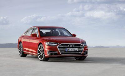 Νέο Audi A8: Νέα γλώσσα σχεδίασης – Πρωτοποριακή τεχνολογία χειρισμού αφής - Κορυφαία ποιότητα κατασκευής» Το νέο Audi A8 σηματοδοτεί μια νέα εποχή σχεδίασης συνολικά για τη μάρκα. Το μπροστινό μέρος με τις κάθετες εντυπωσιακές γρίλιες Singleframe και το μυώδες σχήμα του αμαξώματος, τονίζουν τη σπορ κομψότητα, την τεχνολογική υπεροχή και την κορυφαία ποιότητα κατασκευής. Το Audi Α8 ξεχωρίζει τόσο την ημέρα όσο και τη νύχτα, μέσω των πολύ εντυπωσιακών προβολέων HD Matrix LED με φωτισμό Audi λέιζερ και τη φωτεινή λωρίδα LED σε συνδυασμό με τα πίσω φώτα τεχνολογίας OLED. Αυτά παράγουν μοναδικά φωτεινά κινούμενα μοτίβα καθώς ο οδηγός πλησιάζει ή απομακρύνεται από το αυτοκίνητο. Η ελευθερία είναι το καθοριστικό χαρακτηριστικό της νέας ιδιαίτερης σχεδίασης, κάνοντας το Α8 να μοιάζει με ένα πολυτελές, ευρύχωρο lounge προσφέροντας στους επιβάτες μέχρι και σύστημα για να κάνουν μασάζ στα πέλματα των ποδιών τους. Το εσωτερικό του πολυτελούς sedan υιοθετεί μια minimal σχεδίαση – εσωτερική αρχιτεκτονική και με αυστηρά οριζόντιο προσανατολισμό.. Η Audi μεταφέρει τα υψηλά πρότυπα ποιότητας στην ψηφιακή εποχή με έναν ριζικά νέο τρόπο χειρισμού απομακρύνοντας τελείως το οικείο περιστροφικό κουμπί και το touchpad του προηγούμενου μοντέλου ενσωματώνοντας όλες τις λειτουργίες που υπάρχουν στον πίνακα οργάνων χωρίς κουμπιά και διακόπτες. Ο οδηγός ελέγχει το σύστημα Infotainment με το άγγιγμα του δακτύλου στη μεγάλη οθόνη ενώ μπορεί επίσης να χρησιμοποιήσει μια δεύτερη οθόνη αφής στην κεντρική κονσόλα για να έχει πρόσβαση στις λειτουργίες κλιματισμού και άνεσης. Ο συνδυασμός της ακουστικής και απτής ανάδρασης μαζί με τη χρήση κοινών χειρονομιών αφής καθιστούν τη νέα λειτουργία MMI touch ιδιαίτερα ασφαλή, διαισθητική και γρήγορη στη χρήση.