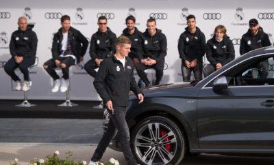 Audi και Ρεάλ Μαδρίτης μαζί και τη σεζόν 2017-2018 • Συνεχίζεται και τη νέα σεζόν η συνεργασία Audi και Ρεάλ Μαδρίτης • Οι ποδοσφαιριστές της πρωταθλήτριας Ισπανίας και κατόχου του Champions League παρέλαβαν τα νέα τους μοντέλα • Στην κορυφή της προτίμησης το Q7, με τα RS μοντέλα να ακολουθούν • Οι αστέρες της Ρεάλ Μαδρίτης δοκίμασαν σε προσομοιωτές την εμπειρία οδήγησης του Audi e-tron FE04, του ηλεκτρικού μονοθέσιου με το οποίο η Audi συμμετέχει στο παγκόσμιο πρωτάθλημα Formula E Και τη νέα σεζόν, η Ρεάλ Μαδρίτης ...οδηγεί Audi! Οι ποδοσφαιριστές της πρωταθλήτριας Ισπανίας παρέλαβαν την εβδομάδα που πέρασε τα προσωπικά τους μοντέλα για την εφετινή χρονιά. Πριν όμως την παράδοση, μία έκπληξη περίμενε τους αστέρες της Μαδρίτης. Άλλαξαν τις ποδοσφαιρικές τους στολές, φόρεσαν αγωνιστικές φόρμες και πήραν θέση σε ειδικούς προσομοιωτές, για να πάρουν μια εντύπωση του Audi e-tron FE04, του ηλεκτρικού αγωνιστικού μονοθέσιου της Audi με το οποίο η μάρκα συμμετέχει στη Formula E. Το μονοθέσιο θα κάνει την παρθενική του εμφάνιση στον εναρκτήριο αγώνα της σεζόν για τη Formula E, στο Χονγκ Κονγκ (2-3 Δεκεμβρίου). Για άλλη μια χρονιά, στην κορυφή της λίστας προτίμησης ήταν το Audi Q7. Το μεγάλο SUV της Audi ήταν επιλογή των Γκάρεθ Μπέιλ (Gareth Bale), Λούκα Μόντριτς (Luka Modrić) και Κασεμίρο (Casemiro) όπως και 11 ακόμα συμπαικτών τους, με τρεις από αυτούς να επιλέγουν το plug-in υβριδικό Audi Q7 e-tron Quattro. Επίσης δημοφιλή ανάμεσα στους «Μαδριλένους» αναδείχθηκαν τα σπορ μοντέλα RS. Ο προπονητής Ζινεντίν Ζιντάν (Zinédine Zidane) επέλεξε το Audi RS 6 Avant, ο super-star της ομάδας Κριστιάνο Ρονάλντο (Cristiano Ronaldo) και ο τερματοφύλακας Κέιλορ Νάβας (Keylor Navas) το Audi RS 7 Sportback. Τέλος, ο αρχηγός Σέρχιο Ράμος (Sergio Ramos) θα οδηγεί τη νέα ποδοσφαιρική σεζόν ένα Audi R8 Spyder. Για την ιστορία, γρηγορότερος στο τιμόνι του προσομοιωτή του Audi e-tron FE04, αναδείχθηκε ο αμυντικός των πραταθλητών Ισπανίας, ο Ντάνι Καρβαχάλ (Dani Carvajal). Η Audi συνεργάζεται με 