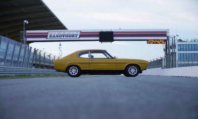 """Ήταν η χρονιά που ο άνθρωπος περπάτησε για πρώτη φορά στη Σελήνη. Τότε πραγματοποιήθηκε και το θρυλικό φεστιβάλ του Woodstock, ενώ την ίδια περίοδο τα πρώτα Boeing 747 πέταξαν στους ουρανούς. Την ίδια ακριβώς χρονιά, πριν από μισό αιώνα, το Ford Capri κυκλοφόρησε για πρώτη φορά στους δρόμους της Ευρώπης. Όταν λανσαρίστηκε το 1969, το Ford Capri διαφημίστηκε ως """"το αυτοκίνητο που πάντα υπόσχεσαι στον εαυτό σου"""" και πάνω από 1,8 εκατομμύρια άνθρωποι κατάφεραν να εκπληρώσουν αυτή την υπόσχεση. Λόγω της αυξημένης ζήτησης, το εργοστάσιο της Ford στην Κολωνία της Γερμανίας, κατασκεύασε τα επόμενα 17 χρόνια, μέχρι και το 1986, αντίτυπα του μοντέλου που εκπροσωπούσαν τρεις διαφορετικές γενιές. Από τότε αμέτρητοι οδηγοί συνέχισαν να αγοράσουν, να οδηγούν, αλλά πρωτίστως να απολαμβάνουν, ένα από τα πιο αναγνωρίσιμα σπορ αυτοκίνητα της Ευρώπης. Ένα νέο βίντεο που σηματοδοτεί τα 50ά γενέθλια του αυτοκινήτου παρουσιάζει ένα σπάνιο RS2600 Capri σε ένα νοσταλγικό ταξίδι: από τη γενέτειρά του μέχρι τα δάση των γειτονικών βουνών Eifel – όπου δοκιμάστηκε διεξοδικά πριν το λανσάρισμα – και στη συνέχεια στην εμβληματική πίστα του Spa, στο Βέλγιο και του Zandvoort, στην Ολλανδία, όπου τα Capri πανηγύρισαν αναρίθμητες νίκες. «Το Capri ήταν το αυτοκίνητο που έδωσε στον καθημερινό άνθρωπο τη δυνατότητα να ζήσει το όνειρό του» δήλωσε ο Steve Sutcliffe, ο δημοσιογράφος που οδήγησε το κλασικό μοντέλο της Ford σε ένα ταξίδι στον παρελθόν. «Σε έκανε να νιώθεις όμορφα πίσω από το τιμόνι, κάτι που εξακολουθεί να συμβαίνει ακόμα και σήμερα. Στην ουσία, ήταν η γνήσια απόλαυση που βιώνεις όταν οδηγείς κάτι διαφορετικό.» Το Capri που πρωταγωνιστεί στο βίντεο, το οποίο προέρχεται από την ιστορική συλλογή της Ford, εφοδιάζεται με V6 κινητήρα και διήνυσε πάνω από 700 χλμ. κατά τη διάρκεια των έξι ημερών που διήρκησαν τα γυρίσματα, συμπεριλαμβανομένων και κάποιων γύρων στην πίστα του Zandvoort. Το αυτοκίνητο, ηλικίας 47 ετών, θα μείνει αξέχαστο! «Έχω ερωτευθεί σφόδρα αυτό το αυτοκίνητο, κυριολεκτικά μου """