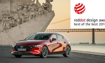 """• Η κριτική επιτροπή επιβράβευσε το μινιμαλιστικό στυλ που εκφράζει την Ιαπωνική αισθητική • Το νέο Mazda3 διαθέσιμο πλέον και με τον επαναστατικό κινητήρα βενζίνης Skyactiv-X Η Mazda τραβά και πάλι όλα τα φώτα της δημοσιότητας με την κατάκτηση του βραβείου """"Red Dot: Best of the Best"""" για το νέο Mazda3. Τα βραβεία σχεδιασμού με την ονομασία Red Dot απονέμονται από διεθνή επιτροπή που αποτελείται από ειδικούς στον τομέα του design, και αφορούν σε προϊόντα που ξεχωρίζουν σε αυτόν τον τομέα. Η τελευταία έκδοση του διαχρονικού best seller της Mazda, παρουσιάζει τη πιο πρόσφατη εξέλιξη της φιλοσοφίας KODO: Τον εξωτερικό σχεδιασμό που βασίζεται στην «ψυχή της κίνησης» (Soul of Motion). Παραλαμβάνοντας το βραβείο μαζί με τον Ikuo Maeda, επικεφαλής σχεδιασμού της Mazda Motor Corporation και τον Jo Stenuit, Διευθυντή Ευρωπαϊκού σχεδιασμού, ο αρχισχεδιαστής του νέου Mazda3 Yasutake Tsuchida δηλώνει: """"Αποφύγαμε τις έντονες γραμμές και άλλα στοιχεία υπερβολής ώστε να μπορέσουμε να εκφράσουμε την καθαρότητα της Ιαπωνικής αισθητικής και να δημιουργήσουμε μία μονοδιάστατη φόρμα κίνησης που να είναι εντυπωσιακά απλή και ταυτόχρονα εκφραστική. Το επίπεδο βελτίωσης είναι προϊόν ανθρώπινου χεριού με τεράστια εμπειρία, και είμαστε ενθουσιασμένοι που αυτό αναγνωρίζεται από την παγκόσμια σχεδιαστική κοινότητα."""" Σε συνδυασμό με την βραβευμένη εμφάνισή του, το νέο Mazda3 εξασφαλίζει και μία ανθρωποκεντρική εμπειρία τόσο στον οδηγό όσο και στους επιβάτες του. Η συμπεριφορά του αυτοκινήτου χαρίζει μία απόλυτα φυσική αίσθηση και την ίδια στιγμή, φιλτράρει με μοναδικό τρόπο κάθε ανεπιθύμητο ερέθισμα από το δρόμο. Η διάταξη του εσωτερικού και τα επιμέρους τμήματα ενισχύουν το βαθμό χρηστικότητας συμβάλλοντας με αυτό τον τρόπο στον περιορισμό της κούρασης. Το συγκεκριμένο μοντέλο είναι επίσης και το πρώτο που εφοδιάζεται με τον επαναστατικό κινητήρα της Mazda με την ονομασία Skyactiv-X. Πρόκειται για τον πρώτο κινητήρα μαζικής παραγωγής στον κόσμο, που διαθέτει αυτανάφλεξη με συμπίεση και συνδυά"""