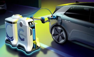 • Το Volkswagen Group Components παρουσιάζει μια νέα, πρωτοποριακή ιδέα φόρτισης • Αυτόνομα κινούμενα ρομπότ θα φορτίζουν τα ηλεκτρικά οχήματα στο μέλλον, χωρίς την παραμικρή ανθρώπινη παρέμβαση • Κάθε χώρος στάθμευσης μπορεί να γίνει σημείο φόρτισης ηλεκτρικών αυτοκινήτων δίχως να απαιτείται οποιαδήποτε ιδιαίτερη υποδομή Η Volkswagen δίνει λύση στο πρόβλημα της αναζήτησης σταθμών φόρτισης για τα ηλεκτρικά αυτοκίνητα. Το Volkswagen Group Components παρουσίασε αυτόνομα κινούμενο ρομπότ φόρτισης που φροντίζει για την επαναφόρτιση των μπαταριών οποιουδήποτε ηλεκτρικού αυτοκινήτου, ενώ το τελευταίο βρίσκεται σε μία κοινή θέση στάθμευσης. Η όλη διαδικασία ξεκινά είτε με ενεργοποίηση μέσω εφαρμογής (app) σε smartphone είτε με V2X (vehicle to everything – όχημα με οτιδήποτε) επικοινωνία. Ακολούθως, το αυτόνομα κινούμενο ρομπότ πλησιάζει το όχημα που χρειάζεται φόρτιση και επικοινωνεί μαζί του. Από το άνοιγμα του πλαισίου υποδοχής φόρτισης για τη σύνδεση του σχετικού βύσματος μέχρι και την τελική αποσύνδεση, η όλη διαδικασία φόρτισης πραγματοποιείται χωρίς ανθρώπινη παρέμβαση. Το ρομπότ είναι συνδεμένο με μία συσκευή αποθήκευσης ενέργειας, θα μπορούσε να χαρακτηριστεί και ως ένα όχημα μπαταρίας, το οποίο ρυμουλκεί, το φέρνει κοντά στο αυτοκίνητο και στη συνέχεια συνδέει αυτοκίνητο και όχημα μπαταρίας, ώστε να ξεκινήσει η φόρτιση. Το όχημα μπαταρίας παραμένει συνδεμένο με το αυτοκίνητο κατά τη διάρκεια όλης της διαδικασίας φόρτισης. Το ρομπότ, εν τω μεταξύ, μπορεί να αποχωρήσει και να προχωρήσει σε αντίστοιχη άλλη φόρτιση, άλλου αυτοκινήτου, καθώς μπορεί να μεταφέρει πολλά οχήματα μπαταρίας ταυτόχρονα. Μόλις ολοκληρωθεί η υπηρεσία φόρτισης, το ρομπότ συλλέγει το όχημα μπαταρίας και το επαναφέρει σε ένα κεντρικό σταθμό φόρτισης. Το κάθε όχημα μπαταρίας έχει ενεργειακό περιεχόμενο περίπου 25 kWh. Με τα ενσωματωμένα ηλεκτρονικά συστήματα φόρτισης, είναι εφικτή ταχεία φόρτιση DC έως και 50 kW για το κάθε αυτοκίνητο. Το ρομπότ, είναι εξοπλισμένο με κάμερες, σαρωτές λέιζερ και αισ